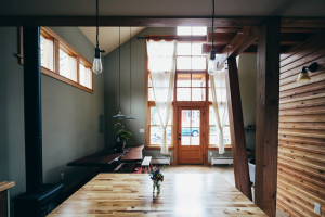 The kitchen is tucked below the loft (photo credit: Christy Cassano-Meyer)